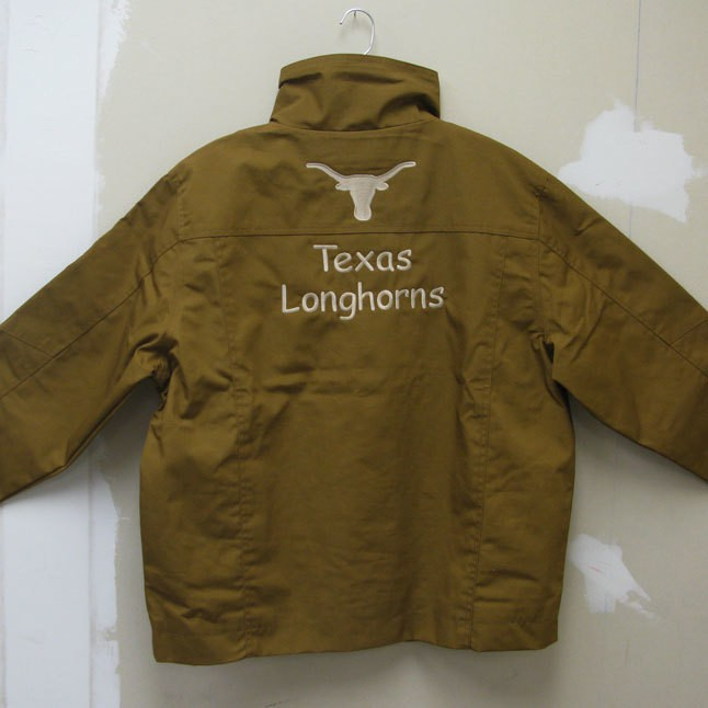 Image of a jacket with the back embroidered with ranch logo